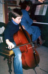 Richard aged 10 playing cello accompanied by his mother on piano